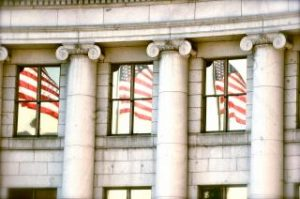 american flag reflecting in courthouse